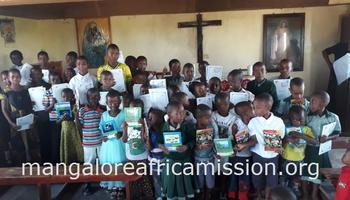 Distribution of books to the students in Kifaru Parish of Same Diocese in Tanzania